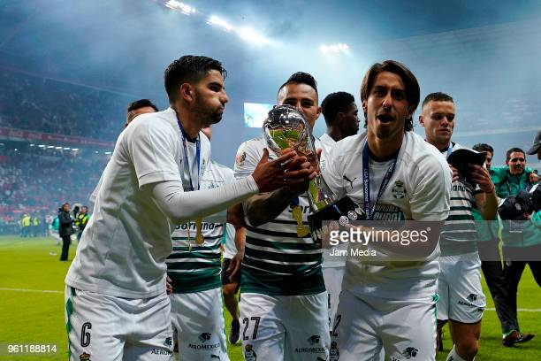 José Abella of Santos Laguna celebrates with the Championship Trophy after winning the Final second leg match between Toluca and Santos Laguna as...