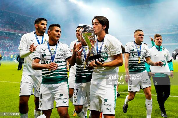 José Abella of Santos Laguna kisses the Championship Trophy after winning the Final second leg match between Toluca and Santos Laguna as part of the...