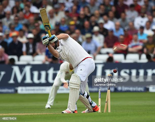 Jos Butler of England is bowled by Mitchel Starc of Australia during day two of the 4th Investec Ashes Test match between England and Australia at...