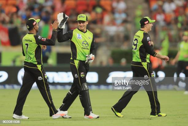 Jos Butler of the Thunder celebrates catching Colin Ingram of the Strikers off the bowling of Gurinder Sandhu of the Thunder during the Big Bash...