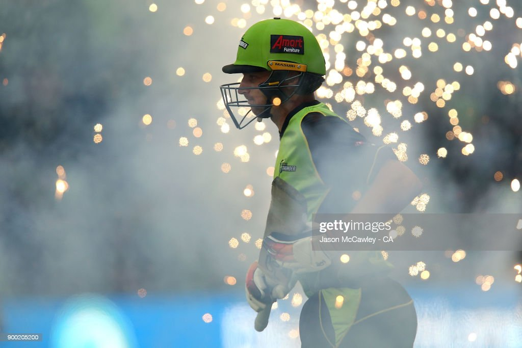 Jos Butler of the Thunder takes thre the field during the Big Bash League match between the Sydney Thunder and the Hobart Hurricanes at Spotless Stadium on January 1, 2018 in Sydney, Australia.