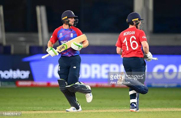 Jos Buttler ad Eoin Morgan of England runs between the wickets during the ICC Men's T20 World Cup match between England and Windies at Dubai...