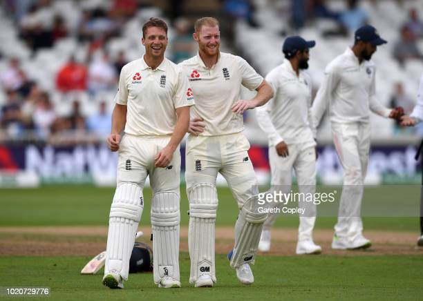 Jos Buttler and Ben Stokes of England wait for drinks during day four of the Specsavers 3rd Test match between England and India at Trent Bridge on...