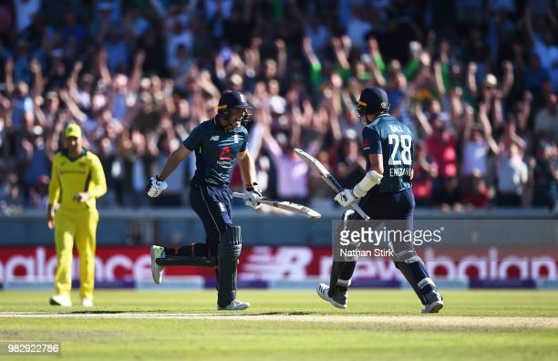 Jos Buttler and Jake Ball celebrate after they win the 5th Royal London ODI match between England and Australia at Emirates Old Trafford on June 24...