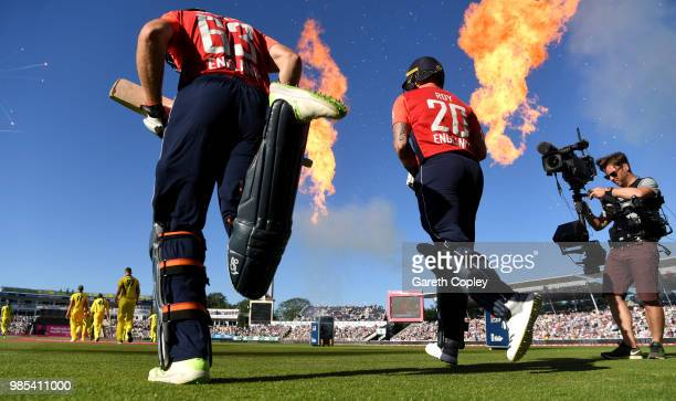 Jos Buttler and Jason Roy of England run on the field ahead of the Vitality International T20 between England and Australia at Edgbaston on June 27...