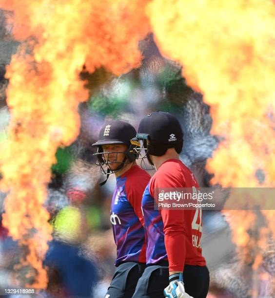 Jos Buttler and Jason Roy of England walk through some pyrotechnics and come out to bat in the 2nd Vitality T20 International between England and...