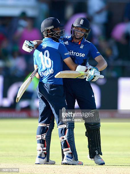 Jos Buttler and Moeen Ali of England celebrate winning the 2nd Momentum ODI between South Africa and England at St George's Park on February 6 2016...