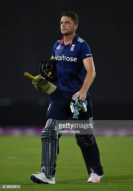 Jos Buttler leaves the field after being dismissed by Taskin Ahmed of Bangladesh during the 2nd One Day International match between Bangladesh and...