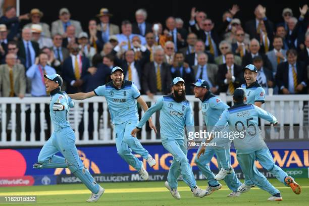 Jos Buttler Mark Wood Moeen Ali Jonny Bairstow Adil Rashid and Chris Woakes of England celebrate in front of the Lord's members after victory off the...