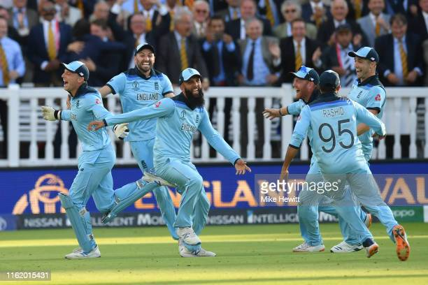 Jos Buttler, Mark Wood, Moeen Ali, Jonny Bairstow, Adil Rashid and Chris Woakes of England celebrate in front of the Lord's members after victory off...