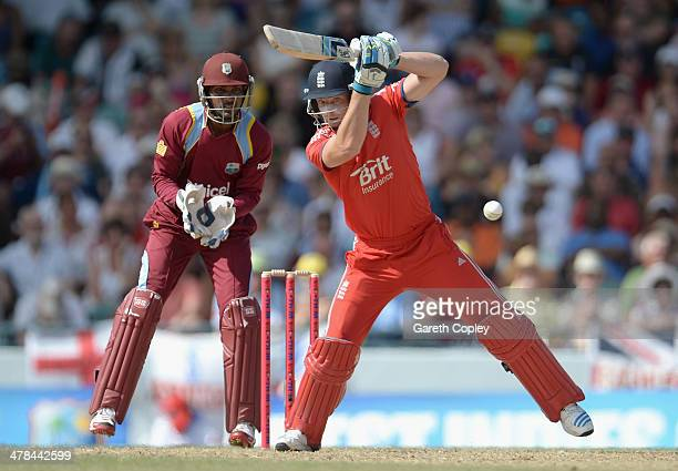 Jos Buttler of England bats during the 3rd T20 International match between the West Indies and England at Kensington Oval on March 13 2014 in...