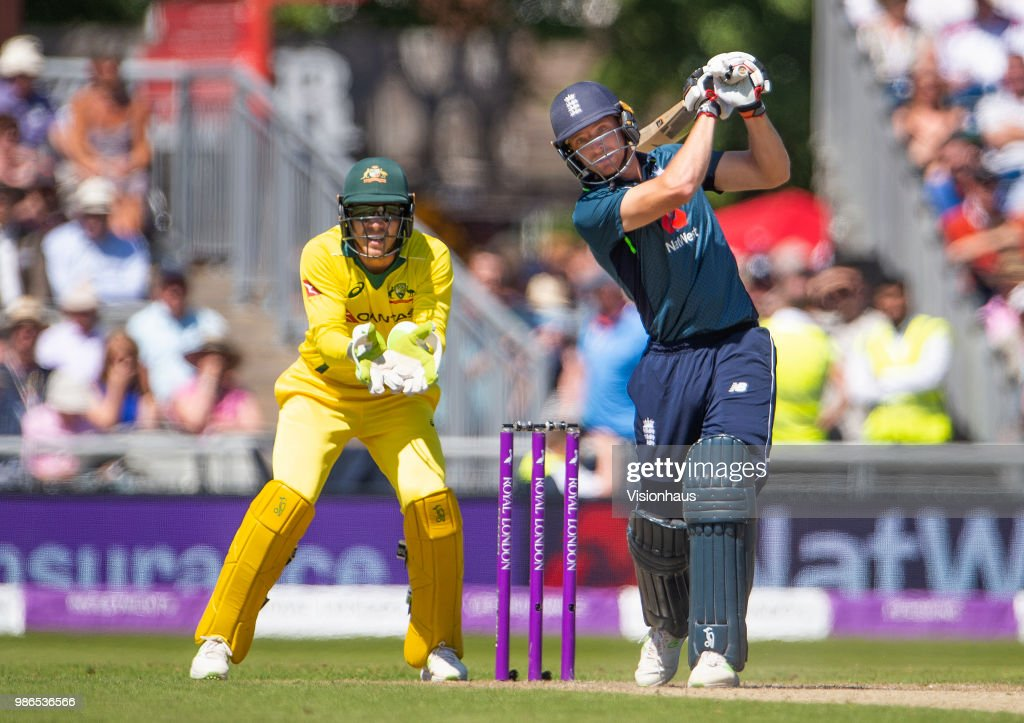 Jos Buttler of England batting as Tim Paine of Australia looks on during the 5th Royal London ODI between England and Australia at the Emirates Old Trafford Cricket Ground on June 24, 2018 in Manchester, England.