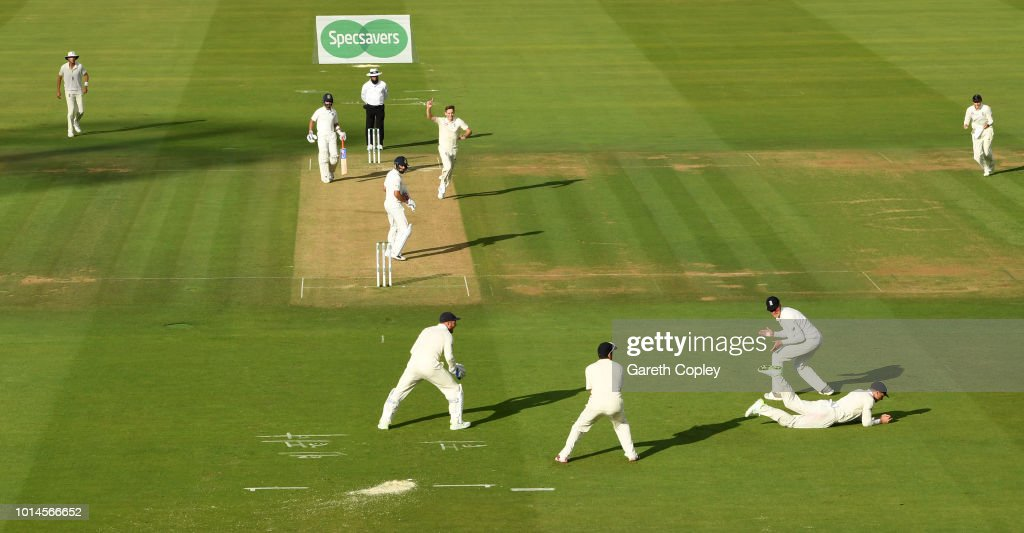 Jos Buttler of England catches out India captain Virat Kohli from the bowling of Chris Woakes during day two of the 2nd Specsavers Test between England and India at Lord's Cricket Ground on August 10, 2018 in London, England.