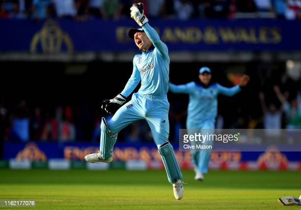 Jos Buttler of England celebrates as he runs out Martin Guptill of New Zealand during the Final of the ICC Cricket World Cup 2019 between New Zealand...