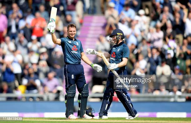 Jos Buttler of England celebrates his century with Eoin Morgan of England during the second One Day International between England and Pakistan at The...
