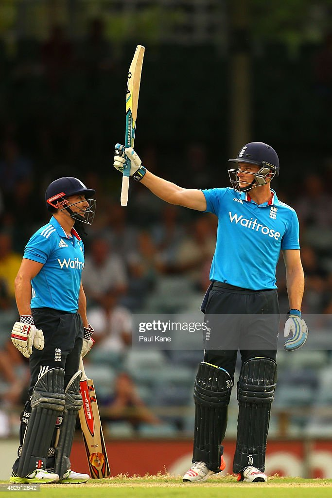 Jos Buttler of England celebrates his half century with James Taylor during the One Day International match between England and India at WACA on January 30, 2015 in Perth, Australia.