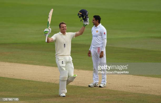Jos Buttler of England celebrates reaching his century as Mohammad Abbas of Pakistan looks on during the second day of the third Test match between...