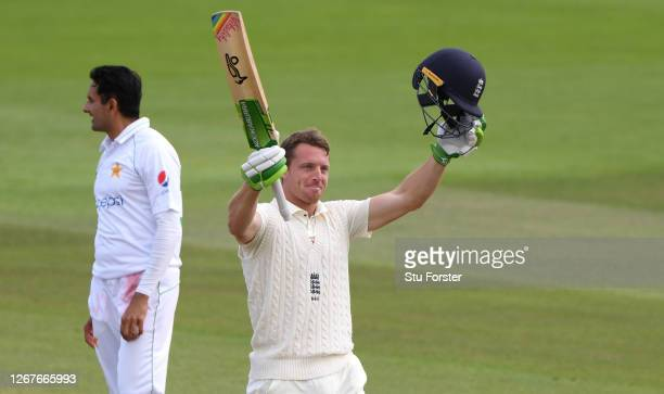 Jos Buttler of England celebrates reaching his century watched on by Mohammad Abbas of Pakistan during Day Two of the 3rd #RaiseTheBat Test Match...