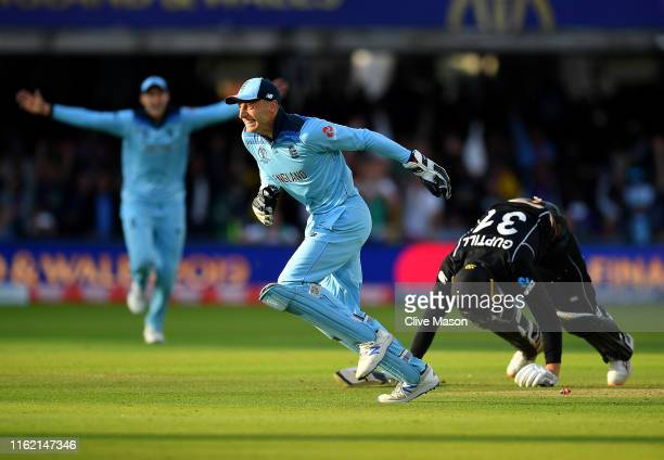 Jos Buttler of England celebrates running out Martin Guptill of New Zealand to seal victory for England during the Final of the ICC Cricket World Cup...