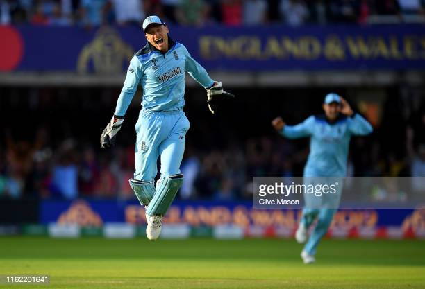 Jos Buttler of England celebrates the run out of Martin Guptill of New Zealand during the Final of the ICC Cricket World Cup 2019 between New Zealand...