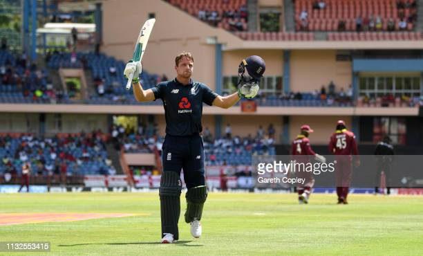 Jos Buttler of England celebrates with teammates as he returns to the dressing rooms during the 4th One Day International match between the West...