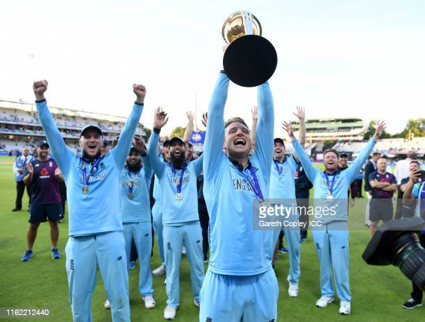 Jos Buttler of England celebrates with the trophy after winning the Final of the ICC Cricket World Cup 2019 between New Zealand and England at Lord's...