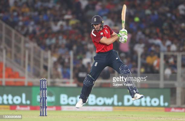 Jos Buttler of England cuts the ball during the 1st T20 International match between India and England at Sardar Patel Stadium on March 12, 2021 in...