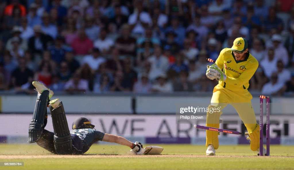 Jos Buttler of England dives for his ground as Tim Paine of Australia breaks the stumps during the fifth Royal London One-Day International match between England and Australia at Emirates Old Trafford cricket ground on June 24, 2018 in Manchester, England.
