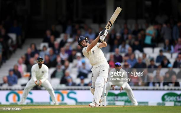 Jos Buttler of England hits out for six runs during day two of the Specsavers 5th Test match between England and India at The Kia Oval on September 8...