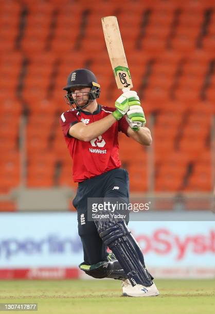 Jos Buttler of England hits runs during the 3rd T20 International between India and England at Narendra Modi Stadium on March 16, 2021 in Ahmedabad,...