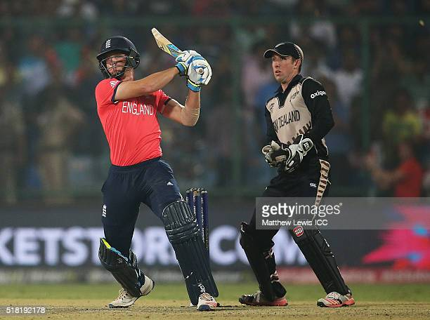 Jos Buttler of England hits the winning runs, as Luke Ronchi of New Zealand looks on during the ICC World Twenty20 India 2016 Semi Final match...