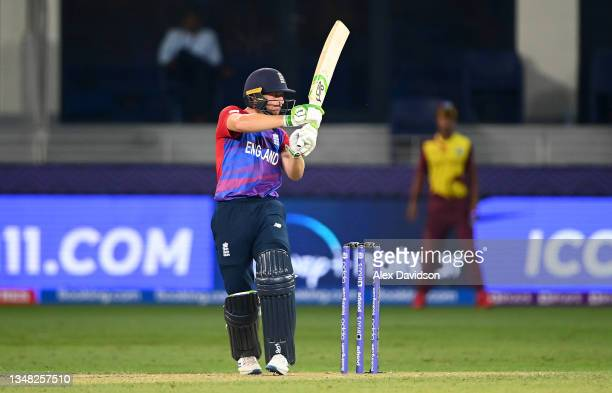Jos Buttler of England hits the winning runs during the ICC Men's T20 World Cup match between England and Windies at Dubai International Stadium on...