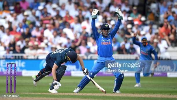 Jos Buttler of England is caught behind by MS Dhoni of India during the Royal London OneDay match between England and India at Trent Bridge on July...