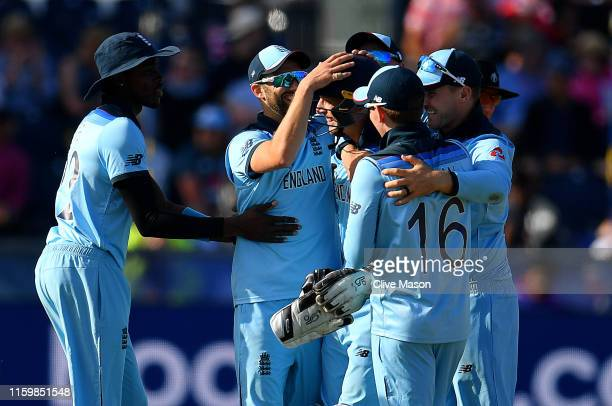 Jos Buttler of England is congratulated after stumping Trent Boult of New Zealand during the Group Stage match of the ICC Cricket World Cup 2019...