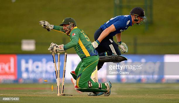 Jos Buttler of England is run out by Pakistan wicketkeeper Sarfraz Ahmed during the 1st One Day International between Pakistan and England at Zayed...