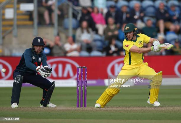 Jos Buttler of England looks on as Tim Paine of Australia scores runs during the 2nd Royal London ODI match between England and Australia at SWALEC...