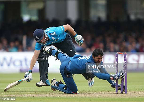 Jos Buttler of England makes his ground as Kumar Sangakkara of Sri Lanka breaks the bails during the 4th Royal London One Day International match...