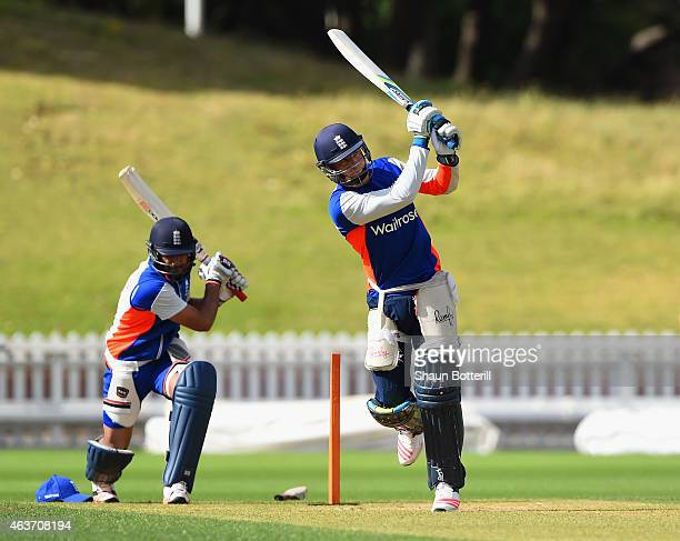 Jos Buttler of England plays a shot as Ravi Bopara practice swings during an England nets session at Basin Reserve on February 18 2015 in Wellington...