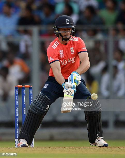 Jos Buttler of England plays the ramp shot during the ICC Twenty20 World Cup warm up match between New Zealand and England at Wankhede Stadium on...