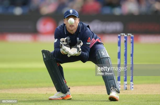 Jos Buttler of England prepares to catch the ball during the ICC Champions Trophy match between England and New Zealand at Swalec stadium on June 6...