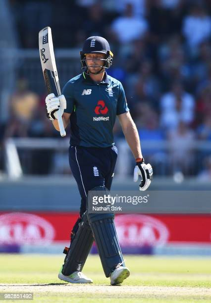 Jos Buttler of England raises his bat after scoring 50 runs during the 5th Royal London ODI match between England and Australia at Emirates Old...