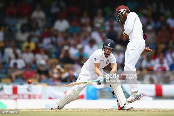 Jos Buttler of England reverse sweeps as Shai Hope of West Indies takes cover during day three of the 3rd Test match between West Indies and England...