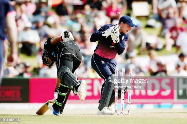 Jos Buttler of England runs out Colin de Grandhomme of New Zealand during game two of the One Day International series between New Zealand and...