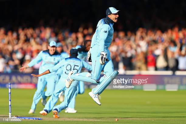 Jos Buttler of England runs out Martin Guptill of New Zealand to seal victory for England during the Final of the ICC Cricket World Cup 2019 between...