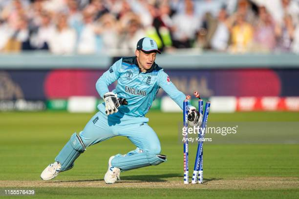 Jos Buttler of England runs out Martin Guptill of New Zealand to win the world cup during the Final of the ICC Cricket World Cup 2019 between New...