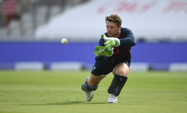 Jos Buttler of England takes a catch during fielding practice during an England Nets Session at Emirates Old Trafford on September 15 2020 in...
