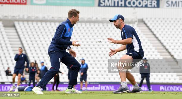 Jos Buttler of England takes part in a fielding drill with coach Carl Hopkinson during a nets session at Trent Bridge on June 18 2018 in Nottingham...