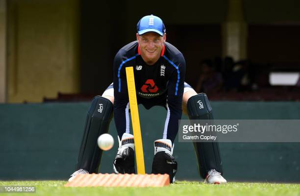 Jos Buttler of England takes part in a wicketkeeping drill during a nets session at P Sara Oval on October 3 2018 in Colombo