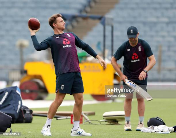 Jos Buttler of England throws an NFL ball during a England Net Session at Maharashtra Cricket Association Stadium on March 22, 2021 in Pune, India.