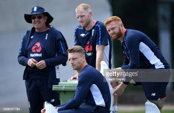 Jos Buttler of England waits to bat with coach Trevor Bayliss Ben Stokes and Jonathan Bairstow during a nets session at Edgbaston on July 31 2018 in...
